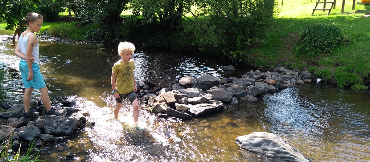 Building dams, catching fish and frogs and splashing around