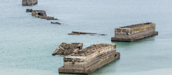 The remains of the Mulberry Harbour are still visible just off the coast at Arromanches