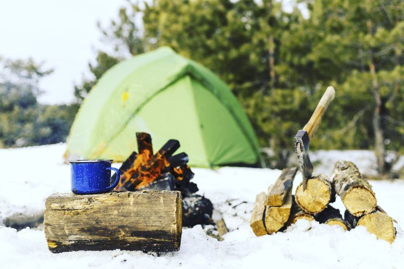 Winter camping with a tent doesn't have to be cold at all with the right preparation
